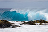 A blue wave breaking at South Point, on the big island of Hawaii. Mar 12, 2007
